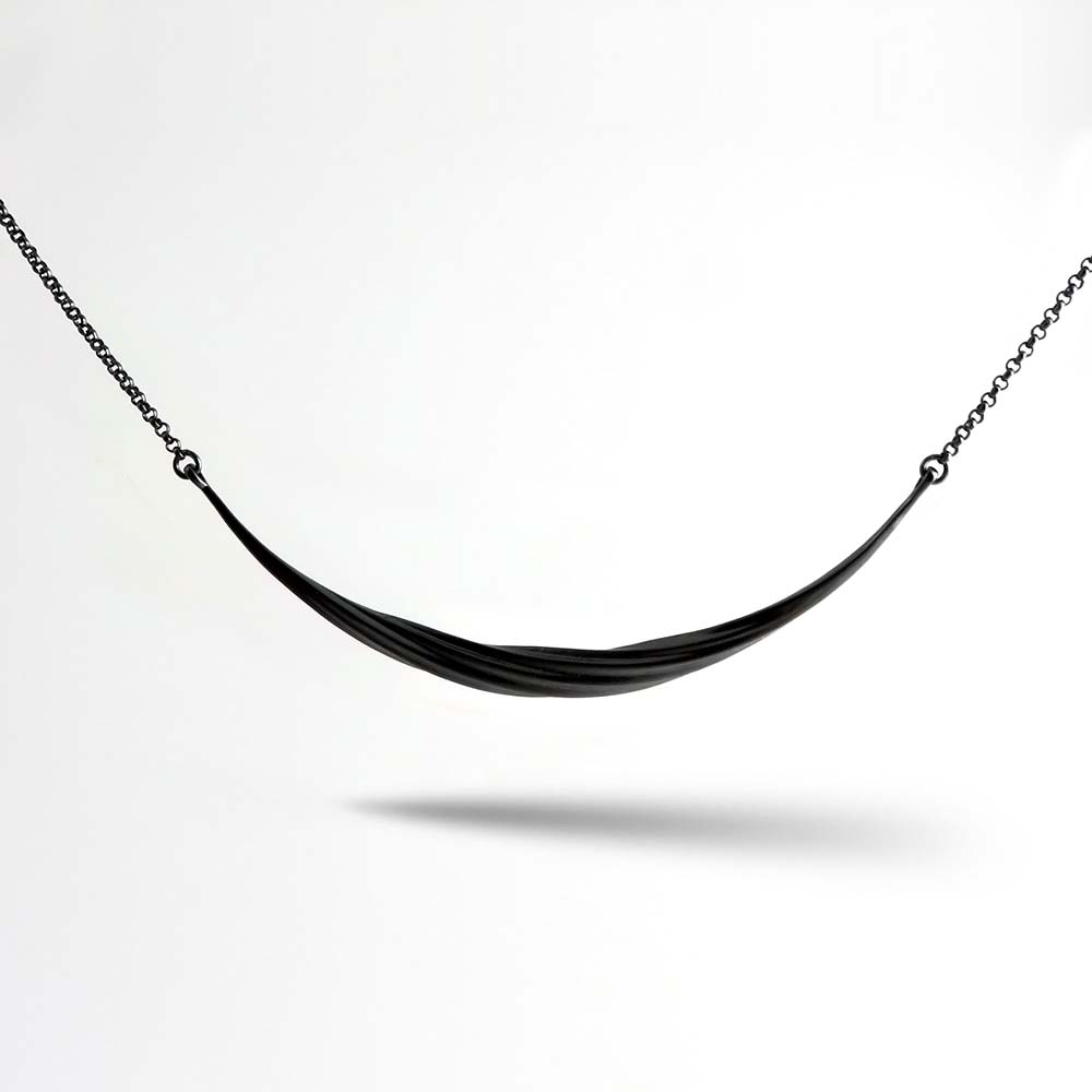 Sterling Silver and Black Rhodium w//Black and White CZ Twisted Pendant
