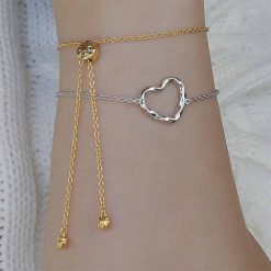 Bracelets from ARY D;PO Designer Jewelry Twisted Heart Bracelet Rhodium Over Sterling Silver