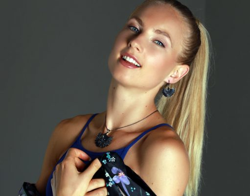 Beautiful girl wrapped in fancy scarf is wearing ARY D'PO Ginkgo Leaf Black Rhodium plated Pendant Necklace and Earrings