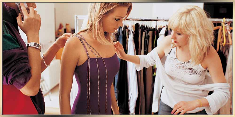 How Stylists Choose Statement Jewelry For Events shown a team of stylists working with their client on choosing her outfit that will match her purple dress and long blond hair