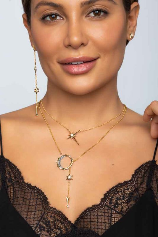 beautiful model with dark hair wearing black top showcasing the ARY D'PO Shiny Stars Jewelry Collection