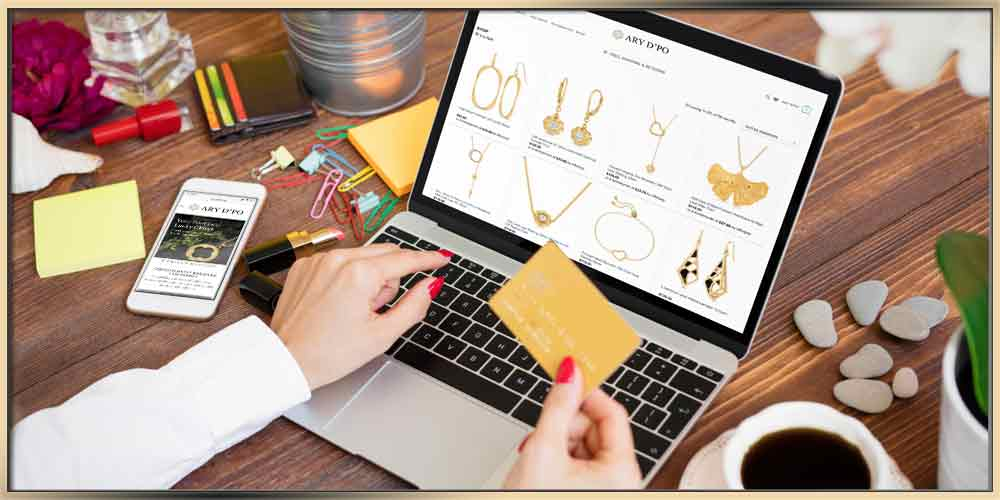 Shopping Online: Best Practices woman holding credit card and shopping jewelry on laptop at ary dpo websit