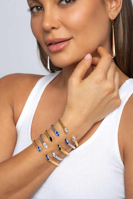 Beautiful woman with banded hand with ARY D'PO Urban Marquise Collection Mate Rhodium and gold Plated Lever back Earrings and cuff bracelets hinged with Swarovski crystals