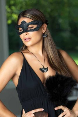 A beautiful woman with long dark hair is wearing a black dress, a fancy mask and ARY DPO Black Ginkgo Jewelry for Why Do Women Love Jewelry blog