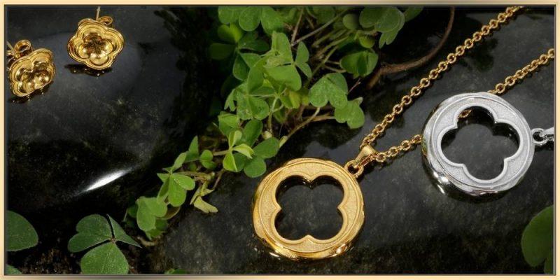 ARY D'PO Four Leaf Clover Quatrefoil Jewelry on dark wet stones