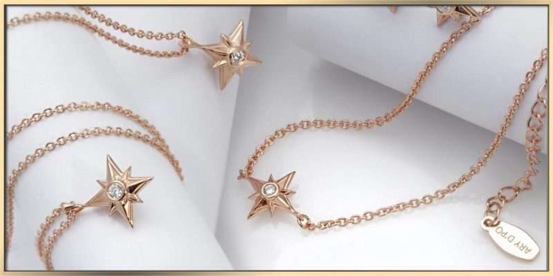 ARY D'PO shiny stars necklaces in rose gold on a white background